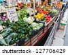 fruit and vegetables stall in a Venetian boat - stock photo