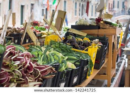 Fruit and vegetables stall in a Venetian boat, Italy - stock photo