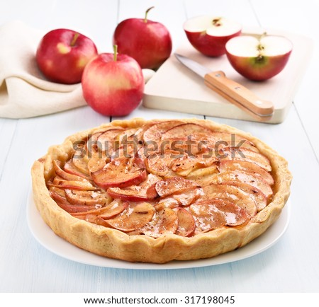 Fruit apple pie on wooden table - stock photo