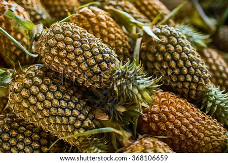 Fruit Background. Closeup Of Organic Ripe Pineapples At Street Farmers Market ( Supermarket ) In Thailand, Asia. Nutrition And Vitamins. Healthy Raw Diet Food.  - stock photo