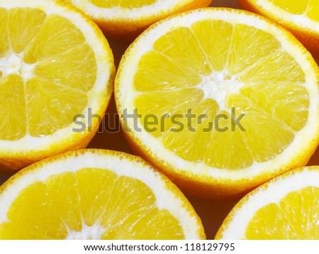 Fruit background. Delicious close-up of fresh, sweet and juicy oranges sliced in cross section.