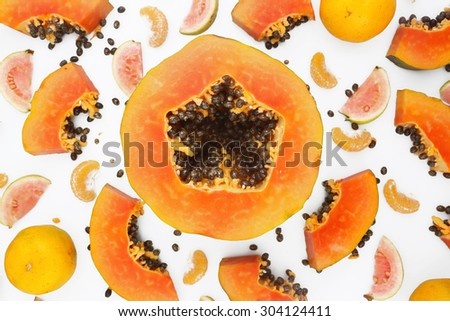 Fruit background - papaya and mandarine on white background - stock photo