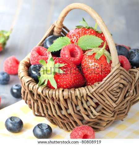 fruit basket with strawberries and blueberries - stock photo