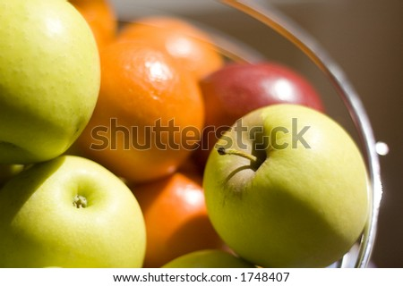 Fruit bowl full of apples and oranges
