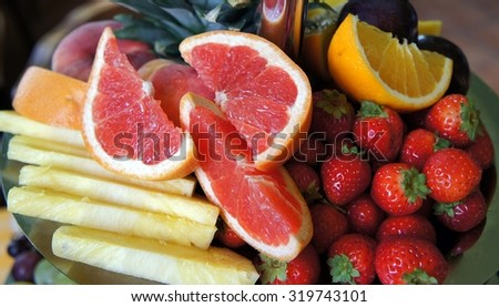 Fruit bowl of various kinds and colors - stock photo