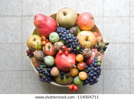 fruit bowl with handpicked organic fruits shot from above - stock photo