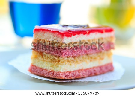 Fruit cake on white paper on the table Shallow DOF - stock photo