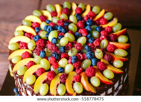 Fruit cake with berries and fruit.