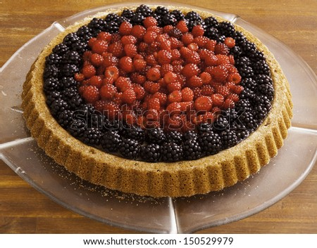 Fruit cake with different sorts of berries - stock photo