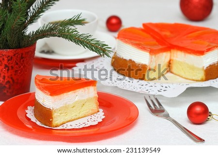 Fruit cake with milk cream and fruit - stock photo