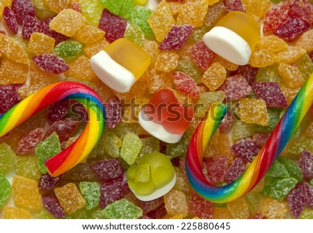 Fruit candies in sugar, marmalade and striped candy closeup