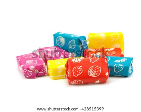 Fruit candies on a white background - stock photo