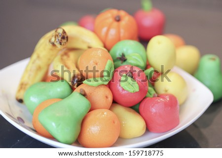 fruit candy made by almond paste or marzipan fruits - stock photo