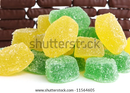 Fruit candy on background of chocolate sweets - stock photo