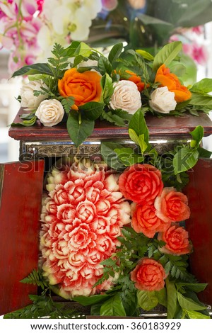 Fruit carvings on the buffet table - stock photo