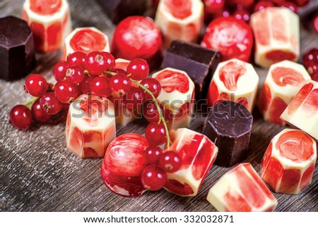 Fruit chocolate. Colorful red and white Small chocolate candy. A delicious mix of colorful chocolate candies with currants