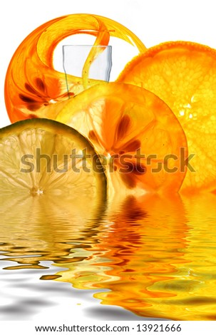 Fruit Cocktail Fountain an unusual  refreshing concept with thinly sliced backlit Orange Lemon and Lime formed around outside of drinking Glass - stock photo