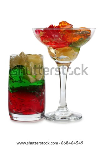 Fruit cocktail in a glass goblet on a white background