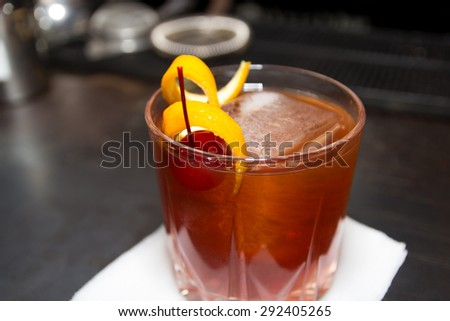 Fruit cocktail in a glass with a cherry and orange - stock photo