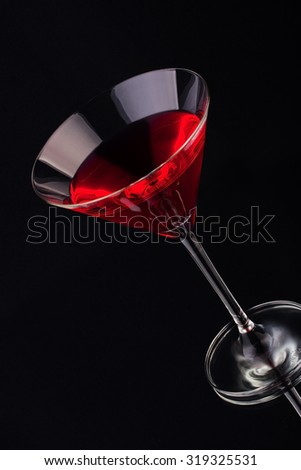 Fruit cocktail in crystal glass on a dark background  - stock photo