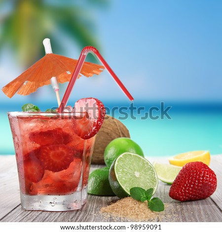 Fruit cocktail on a beach - stock photo