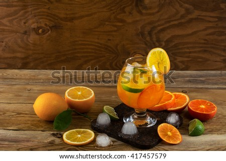 Fruit cocktail on wooden table, copy space. Fruit cocktail. Fruit drink. Summer drink. Citrus lemonade. Fruit lemonade. - stock photo