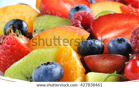 Fruit cocktail with fresh berries and fruits . - stock photo