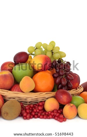 Fruit collection in and surrounding a rustic wooden basket, isolated over white background. - stock photo