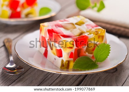 fruit dairy, red and green jelly on a plate  - stock photo