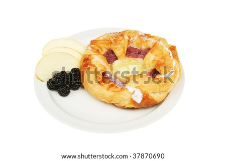 Fruit Danish pastry with a garnish on fruit on a plate - stock photo