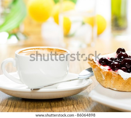 Fruit dessert and coffee