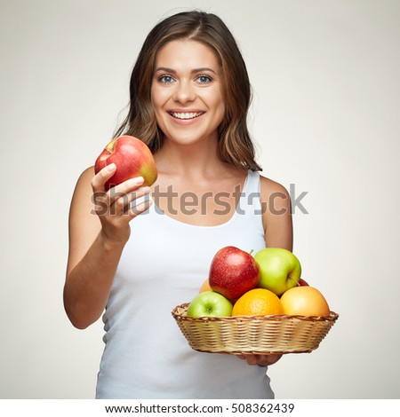 fruit diet for young healthy woman with apples and citrus. isolated portrait smiling girl.