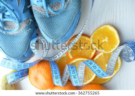 fruit diet.On diet.Fresh oranges , bananas,tangerines. Diet for Weight Loss.healthy eating, healthy lifestyle concep.Measuring tape  - stock photo