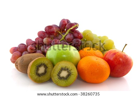 Fruit diversity with grapes kiwis tangerines and apples