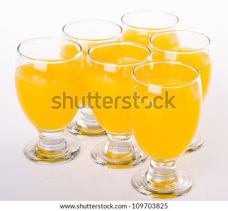 Fruit drink in glasses. Isolated on white - stock photo