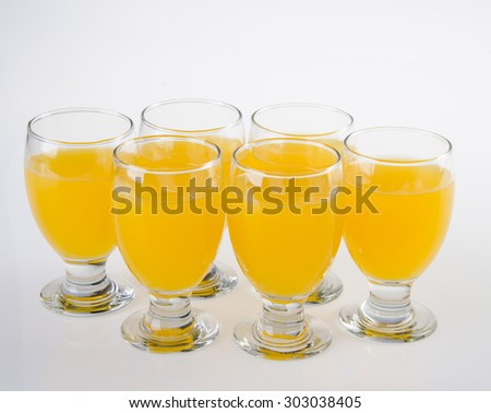 Fruit drink in glasses. Isolated on white