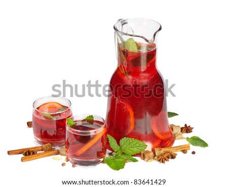 Fruit drink in jug and two glasses. Isolated on white - stock photo