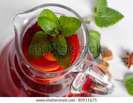 Fruit drink in jug .Closeup - stock photo