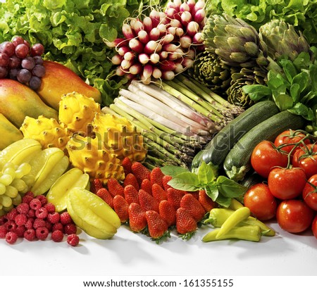 Fruit, exotic fruit and veggies on display - stock photo