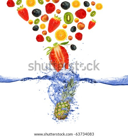 Fruit falling down to the water - stock photo