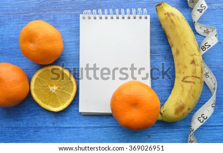 fruit  for slimming.measuring tape.concept of weight loss