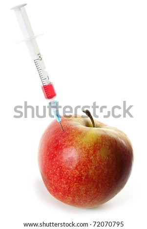 Fruit GMO. Apple pricked syringe with chemical preparation on a white background - stock photo