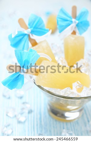 Fruit ice cream popsicle in glass bowl - stock photo
