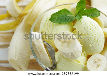 fruit ice cream with fresh banana and mint - stock photo