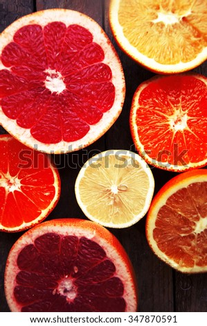 Fruit in a cut closeup, grapefruit, orange, lemon, tangerine, fruit background. rustic food. fruit. Fresh fruits.Mixed fruits background.Healthy eating, dieting, love fruits. - stock photo