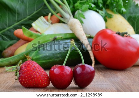 Fruit in foreground and vegetables in background, shallow depth of field - stock photo