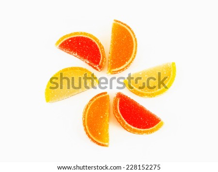 fruit jellies in form citrus on white - stock photo