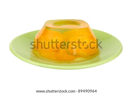 fruit jelly on a green plate isolated on white background - stock photo