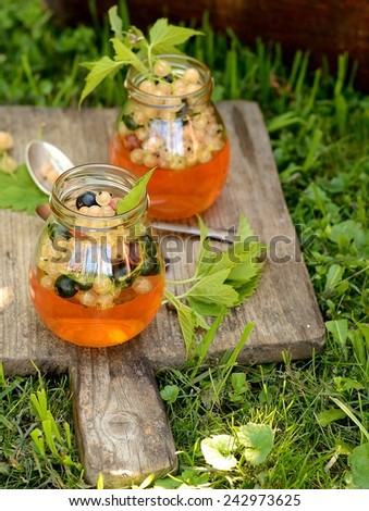 Fruit jelly with champagne. outdoor. Rustic style. - stock photo