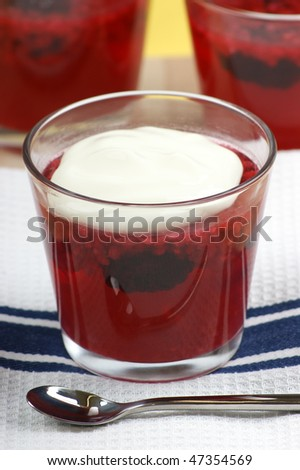 fruit jelly with cream in a glass